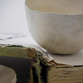 Silver bowl and book